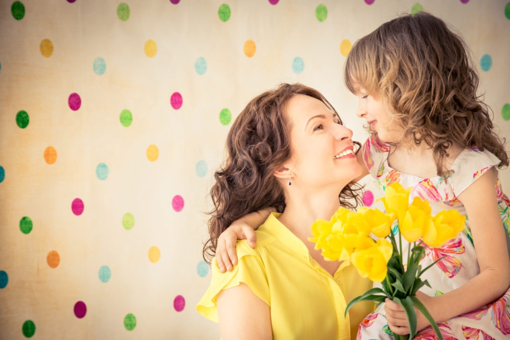 Mother and daughter holding a bouquet of flowers